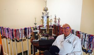 Alumnus Don Morris with his athletic awards