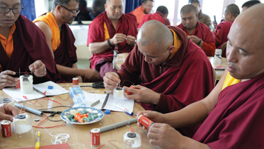 Buddhist monks engaged in a science experiment