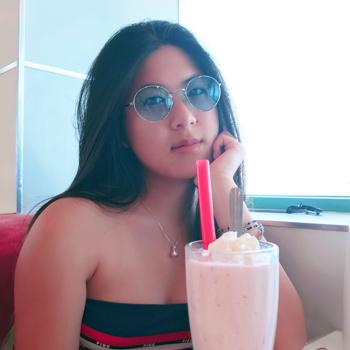 Amy Ru drinking a milkshake