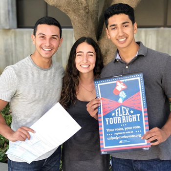 Brett Raffish, Jasmin Fashami and Kabir Shahi holding a Flex Your Right poster and ballot