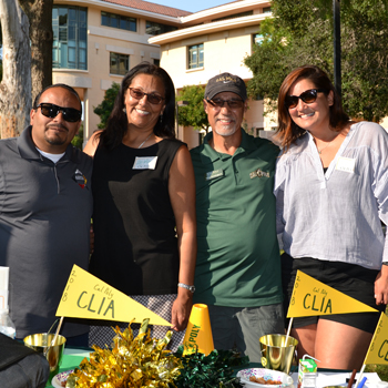 Cal Poly Chicana/o Latina/o and Indigenous Alumni Chapter (CLIA) leaders Oscar Navarro, Lucía Stone, Tony Domingues and Delfina Medina host an event on campus