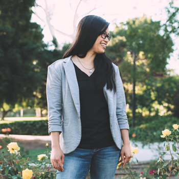 Kristina Wong smiles in the Cal Poly Rose Garden