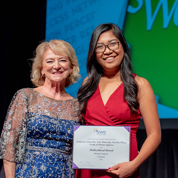 Samantha Galicinao receives an award on stage at the WE18 conference