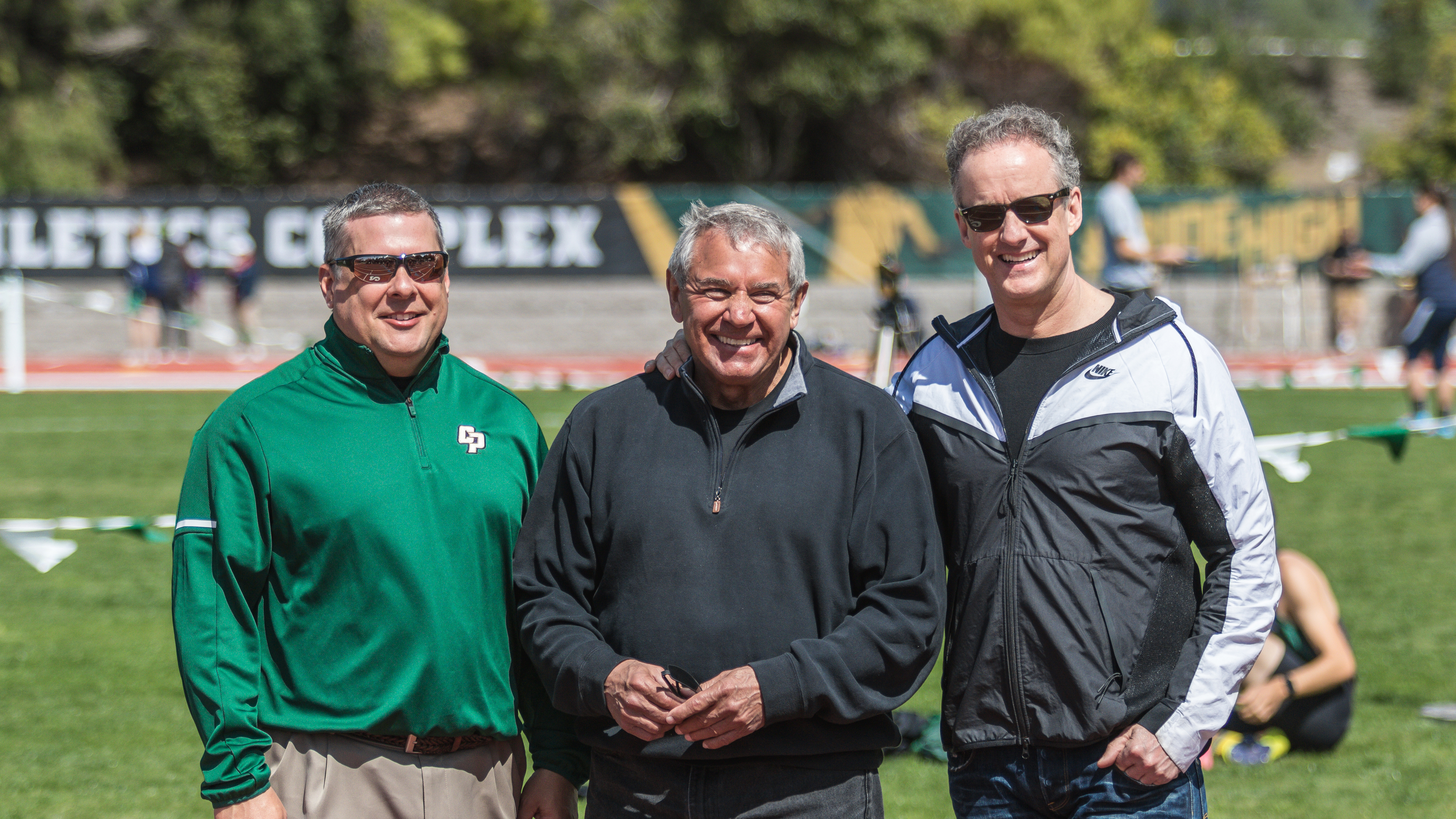 Cal Poly athletic director Don Olberhelmen with donors Steve Miller and John Capriotti