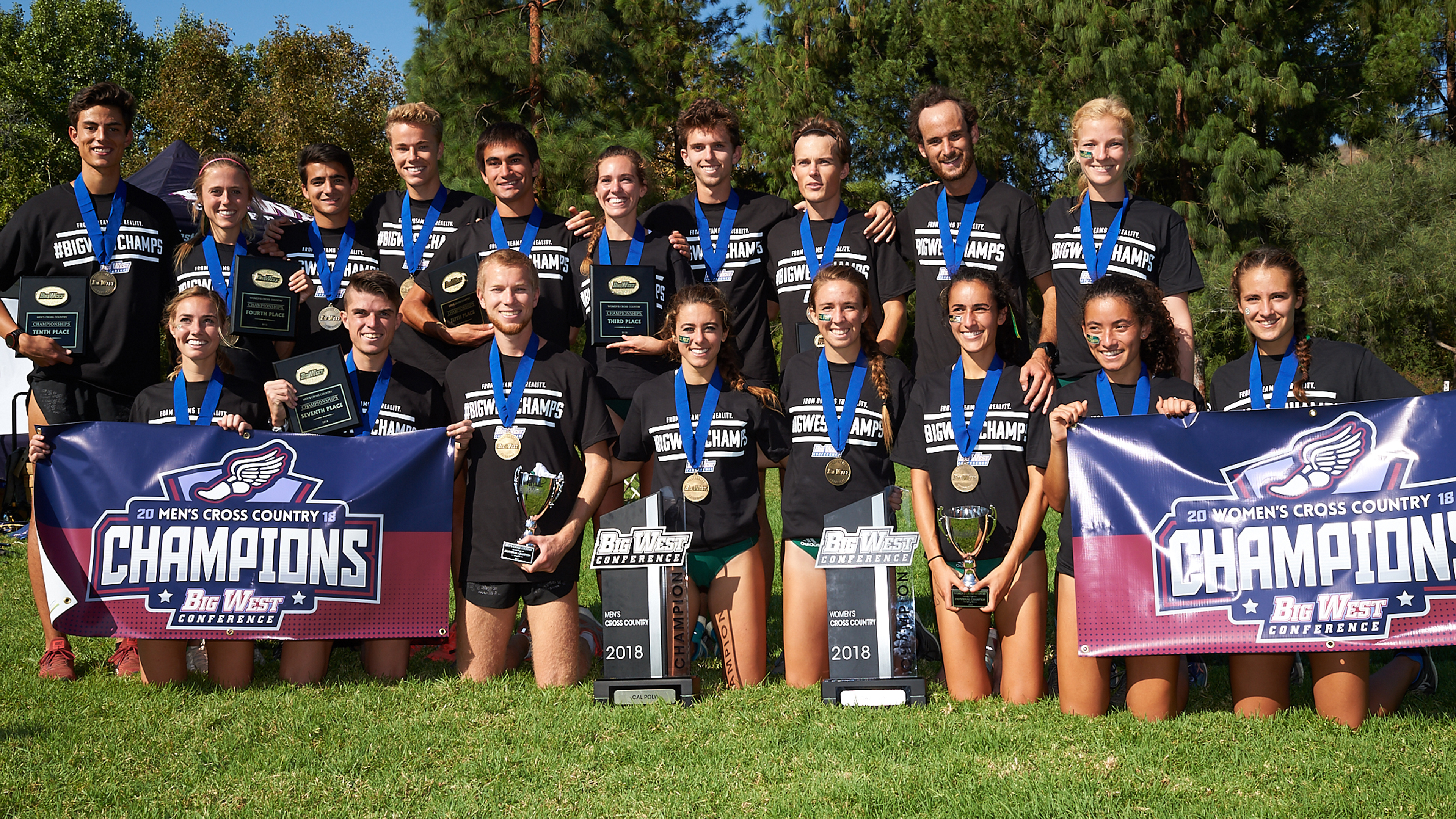 Cal Poly Cross Country Teams pose with Big West trophies and banners