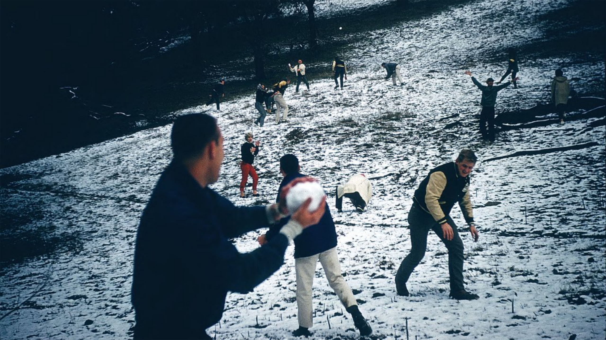 A student prepares to throw a snowball at a group of other students at Cal Poly in 1962. Photo courtesy of University Archives.