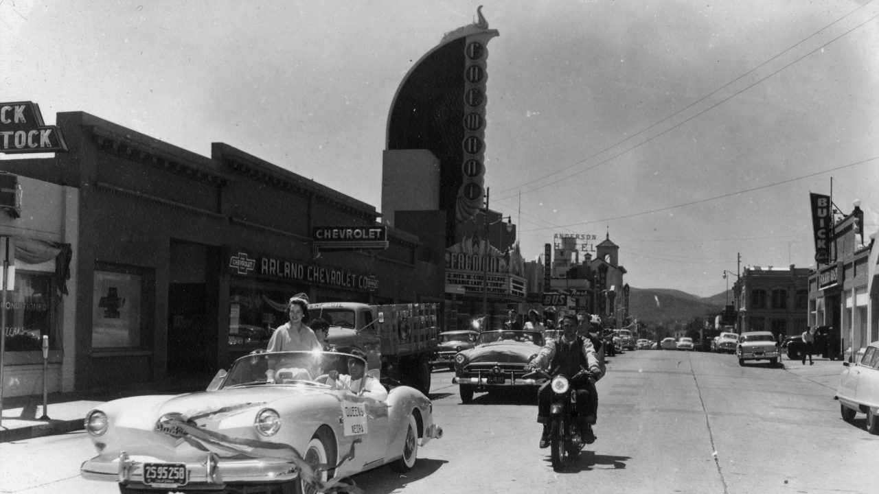 Cars parade down Monterey Street in front of the Fremont Theater in 1955. Photo courtesy of University Archives.