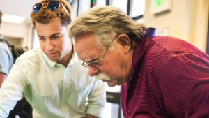 Architect and Cal Poly alumnus Glenn Bruno looks at design presentation with student Foster Westover in Paradise, CA. Photo by Joe Johnston.