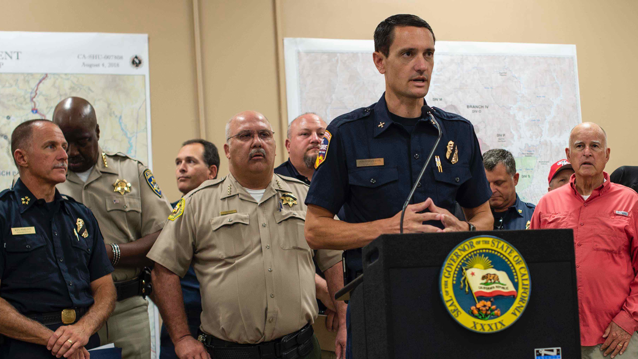 Fire Chief Jonathan Cox speaking at a press conference with Governor Brown regarding the Carr Fire in July 2018