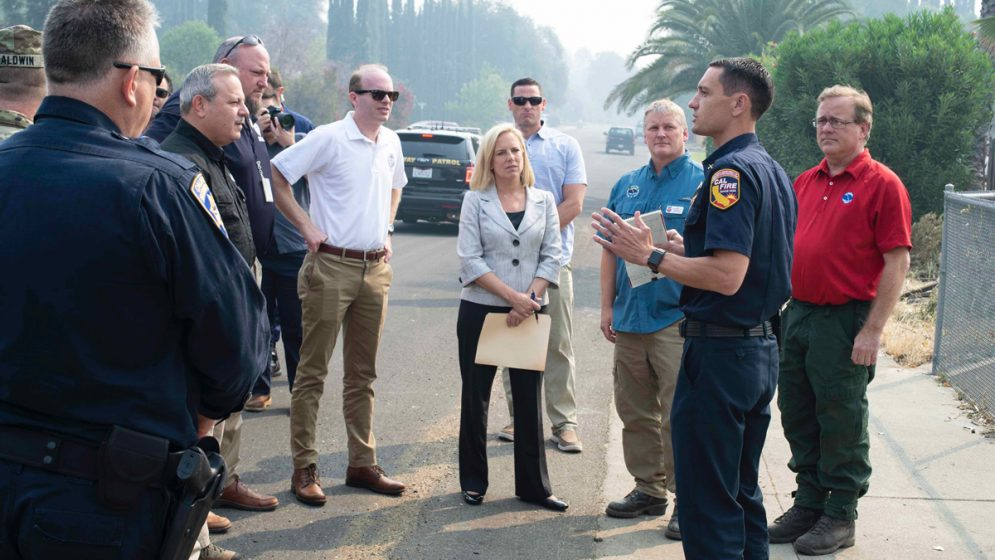 Fire Chief Jonathan Cox addresses leaders, including Homeland Security Secretary Kijrsten Nielsen, in Redding, CA, during the Carr Fire