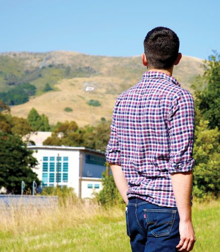 Larry Peña looks toward the P on Cal Poly's campus