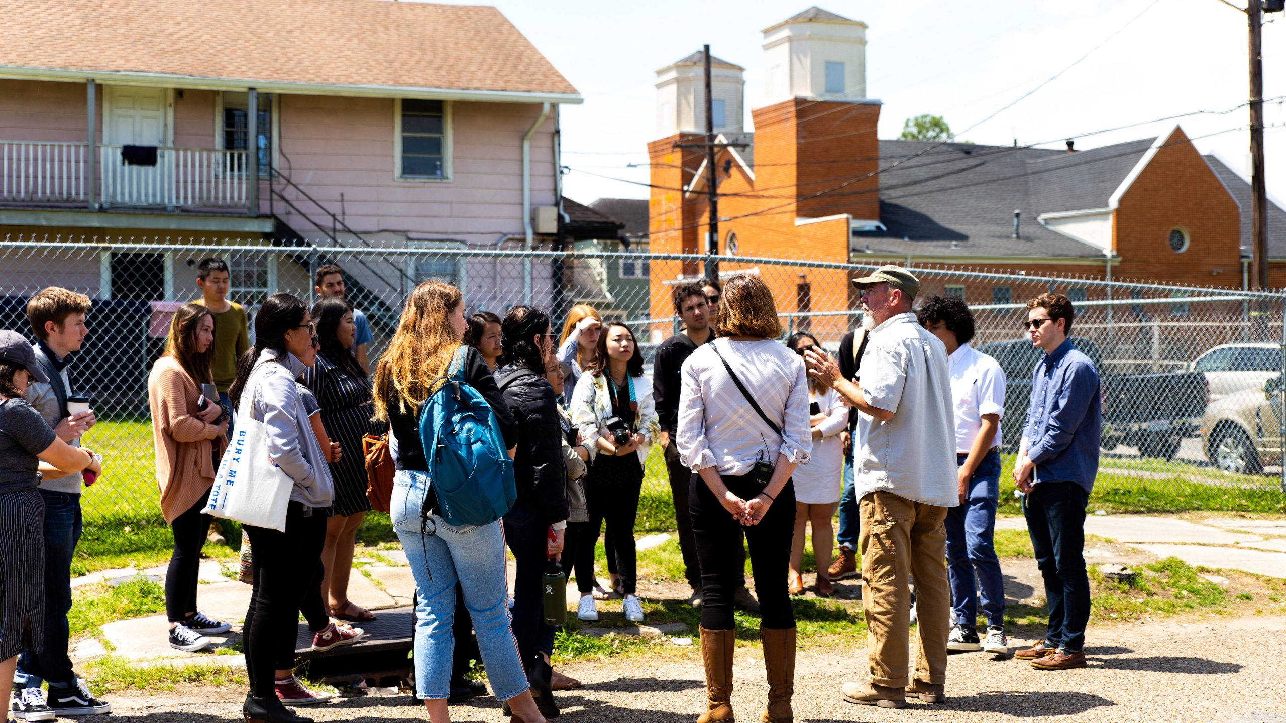A group of Cal Poly students listen while Tulane faculty member Byron Mouton talks about the URBANbuild program. Photo by Robyn Kontra Tanner.