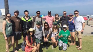 Fourteen members of the San Diego Alumni Chapter at a local beach clean up day in 2018.