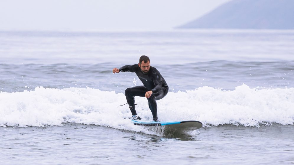 Kyle Kelly tests a prosthetic ankle engineered for surfing while riding a wave in Morro Bay, California