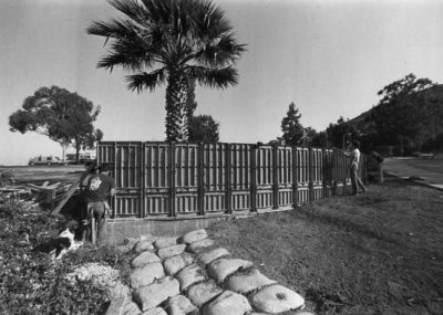 Students construct the entrance to Cal Poly on Grand Avenue