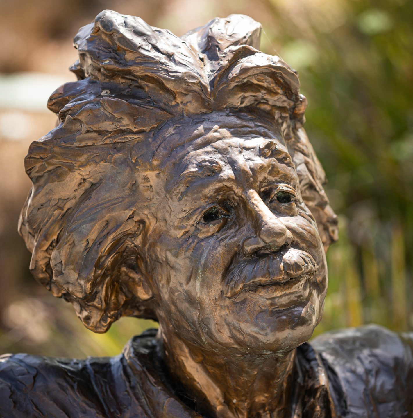 The face of a bronze statue of Albert Einstein