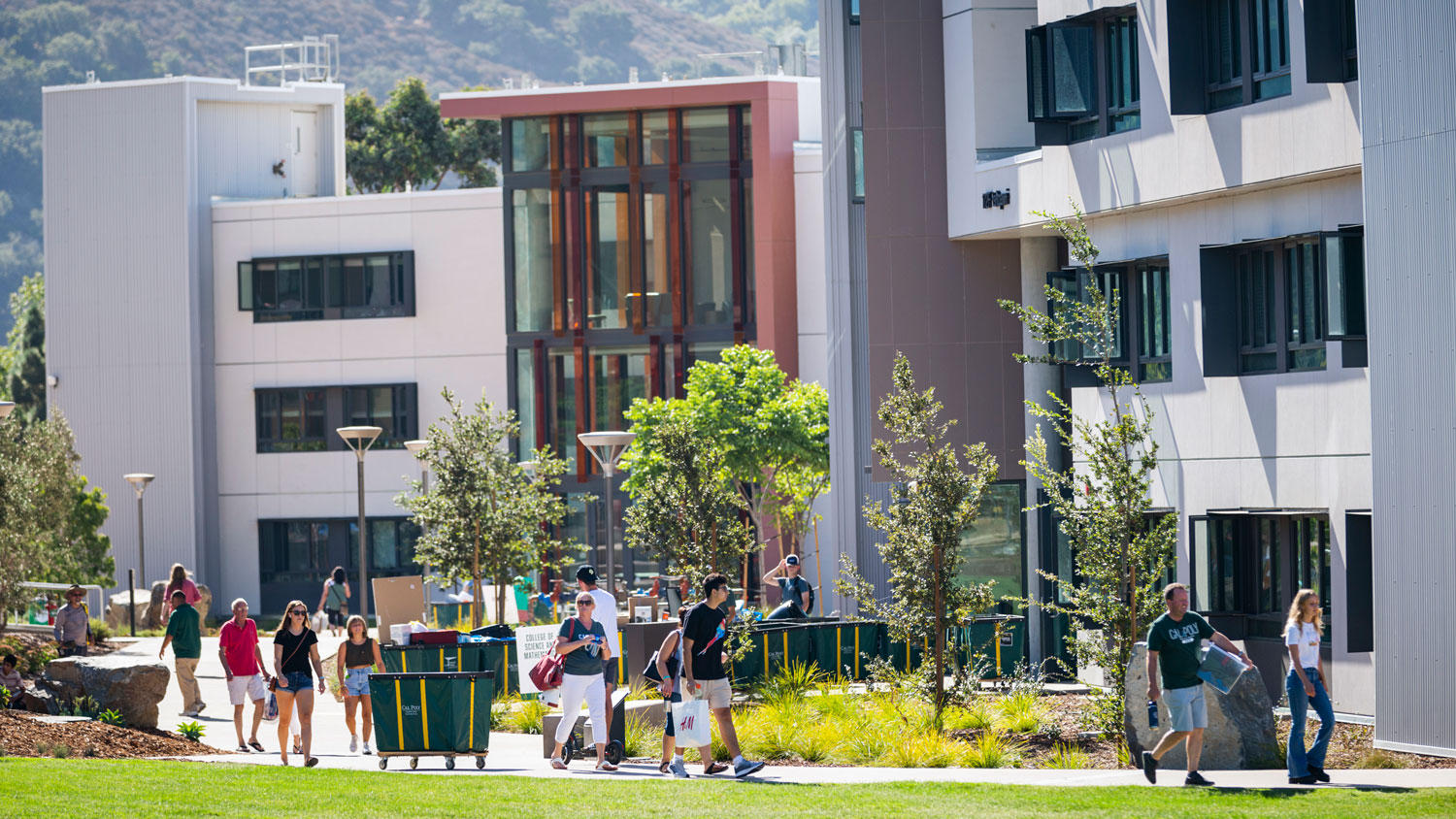 Students and parents push carts on move-in day at the yakʔitʸutʸu residence halls.