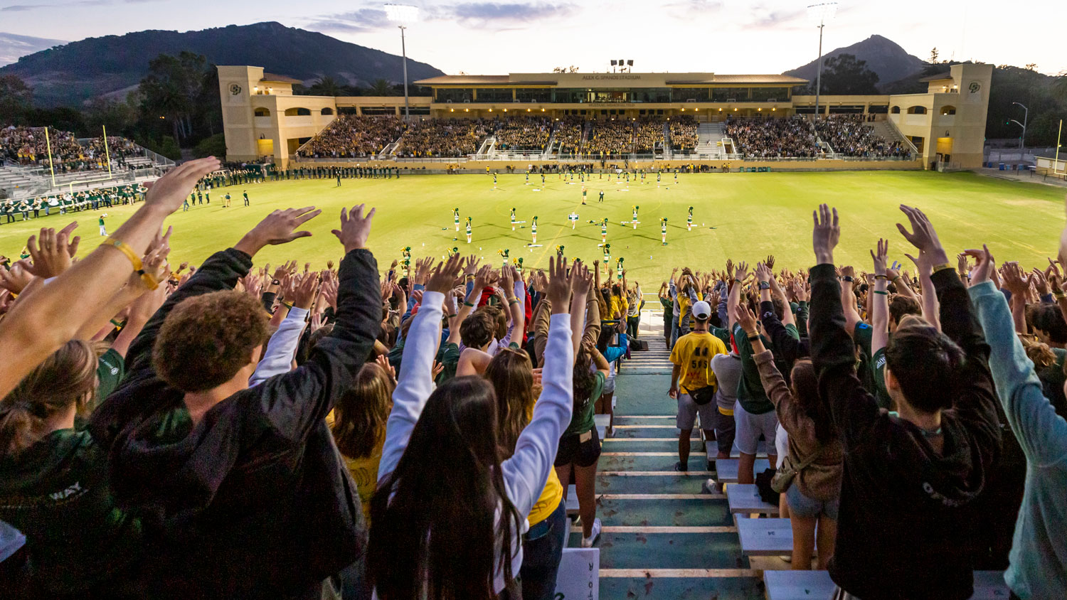 Students cheer in the stands of Spanos Stadium at Big Fall Welcome