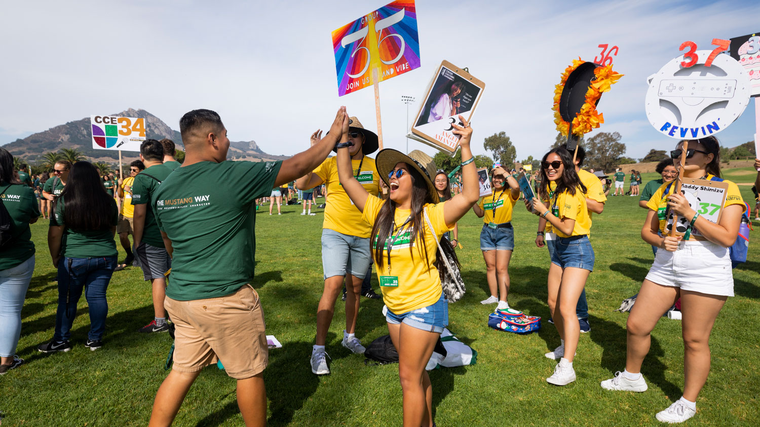 A WOW leader and group member high five enthusiastically at Cal Poly