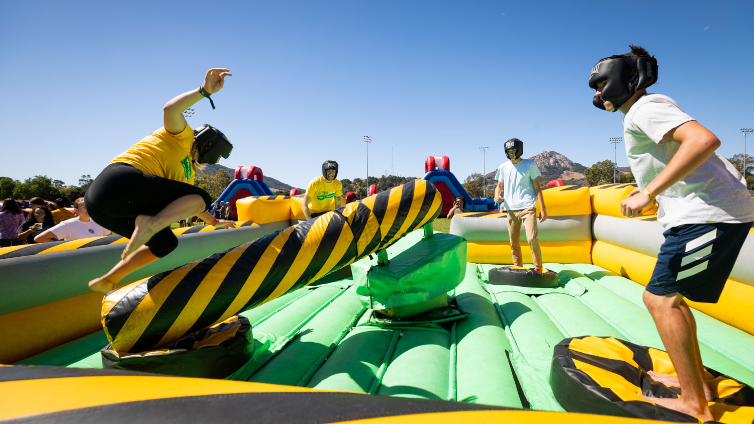 "Four students dodge inflatable obstacles at Week of Welcome's ""Inflat-a-fest"""