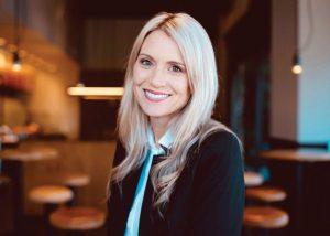 Alumna Kerry Bridges smiles inside a Chipotle restaurant