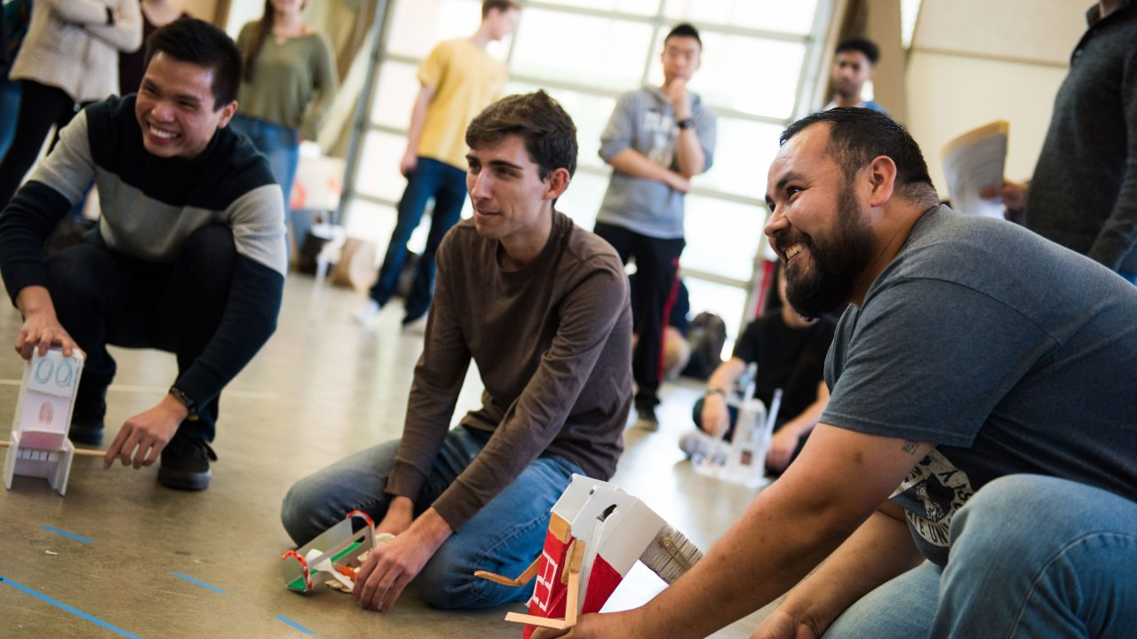 A team of Cal Poly engineering students operate models they've built in a Learn by Doing lab