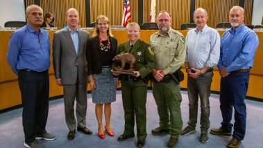 Game warden Anastasia Norris accepts an award from the California Department of Fish and Wildlife's Law Enforcement Division