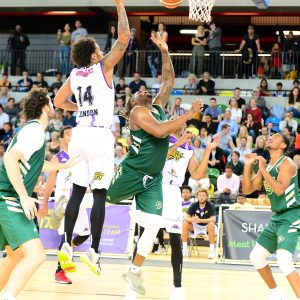 Cal Poly men's basketball athletes plays against the London Lions