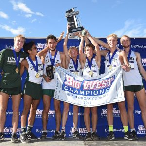 The Cal Poly men's cross country team holds their Big West Championship trophy above their heads