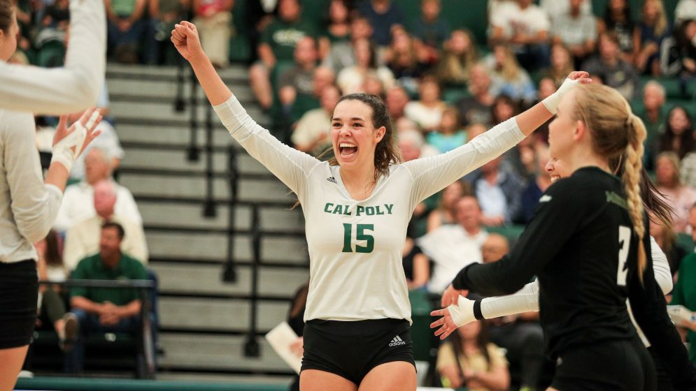Cal Poly volleyball athlete Maia Dvoracek celebrates with her teammates in Mott Athletic Center