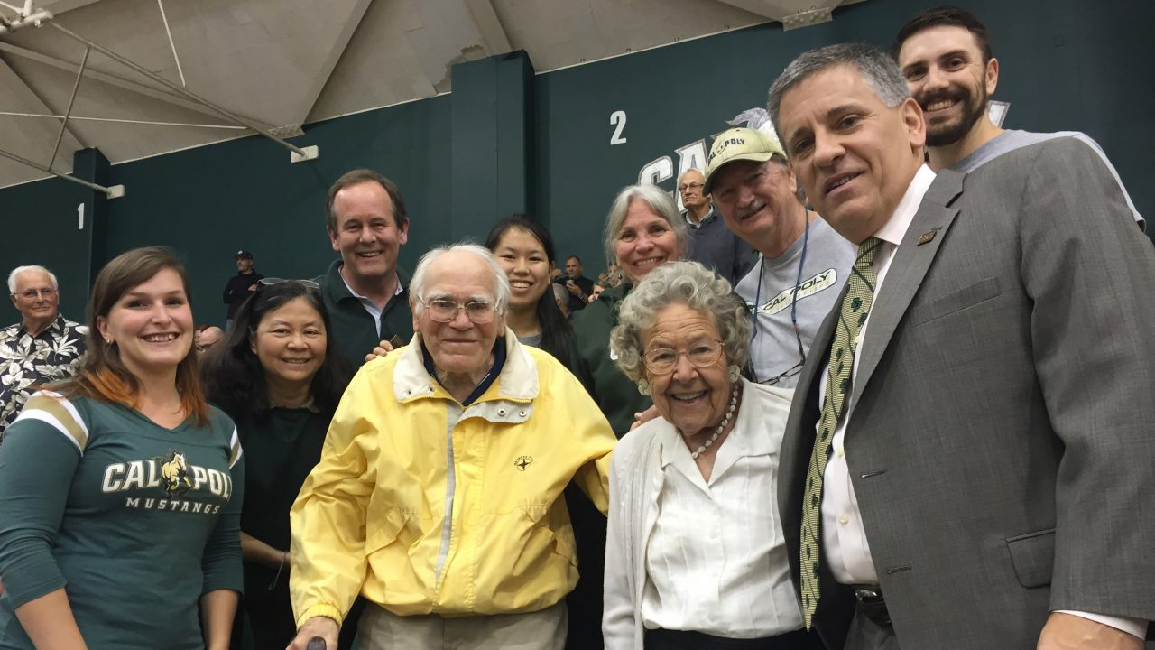 Cal Poly's President Armstrong smiles with Everett Chandler and several family members