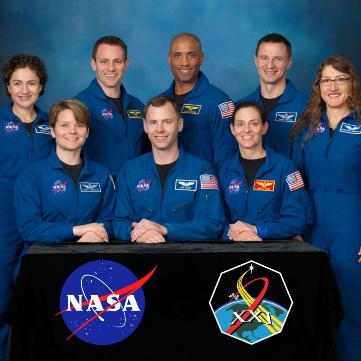 Seven people smile in blue flight suits as NASA's 21st class of astronauts