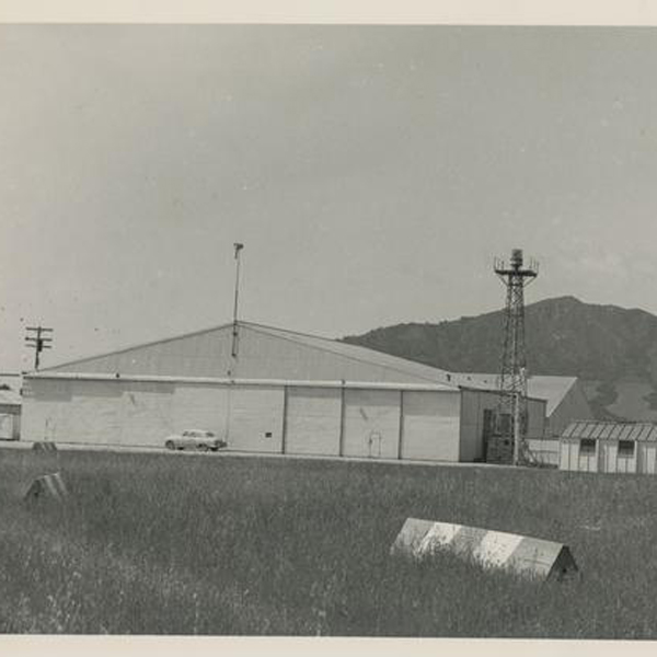A black and white image of the Cal Poly aeronautics hanger