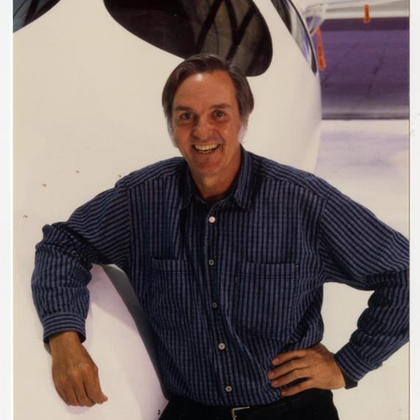 Burt Rutan smiles next to SpaceShipOne