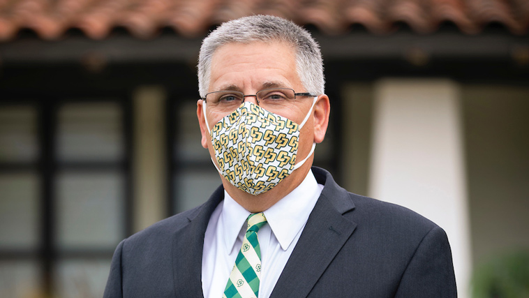President Armstrong wears a face mask on campus