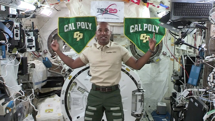 Astronaut Victor Glover waves on screen while chatting with Cal Poly engineers via Zoom