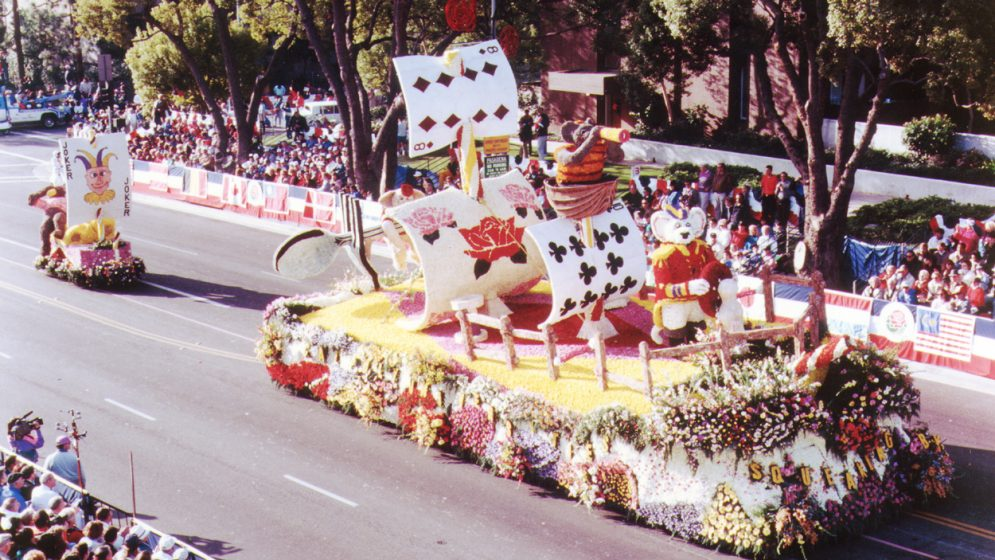 A rose-covered parade float depticting mice and a playing-card ship