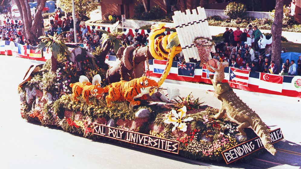 A rose-covered parade float depicting animals playing basketball