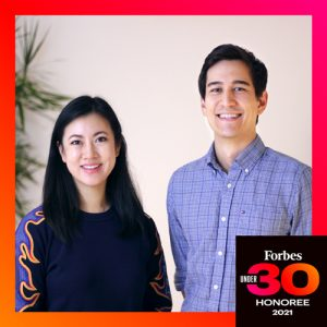 Jenn Chin and her cofounder smile in a photo framed in red with the words 'Forbes 30 Under 30 Honoree 2021'