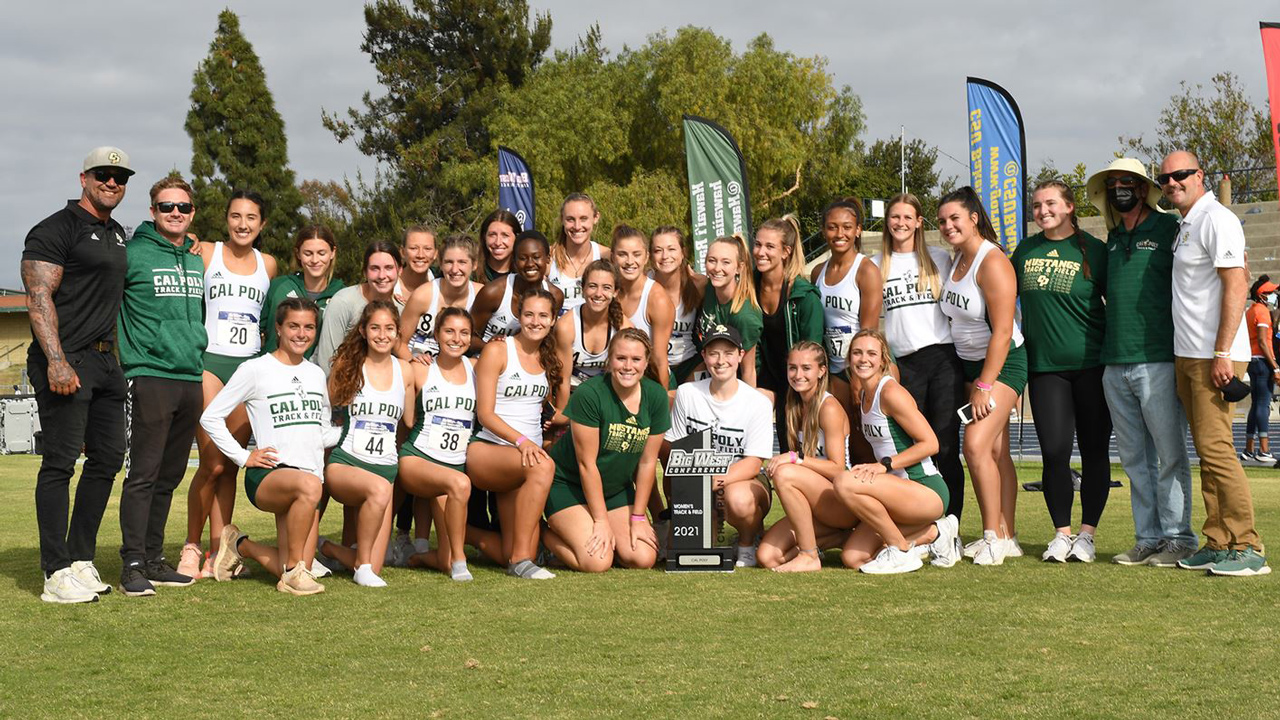 Members of Cal Poly's women's track and field team smiles with coaches