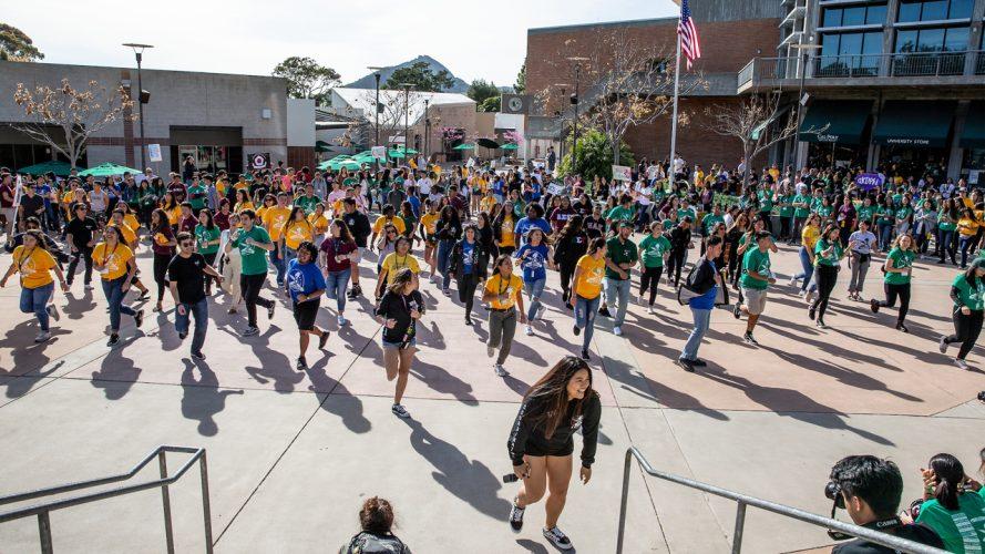 A flash mob dances in Cal Poly's UU Plaza